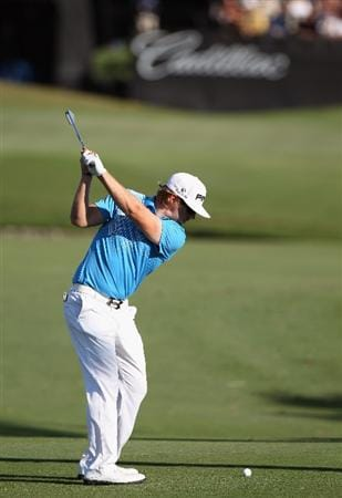 DORAL, FL - MARCH 11:  Hunter Mahan hits a shot  on the 18th hole during the second round of the 2011 WGC- Cadillac Championship at the TPC Blue Monster at the Doral Golf Resort and Spa on March 11, 2011 in Doral, Florida.  (Photo by Sam Greenwood/Getty Images)