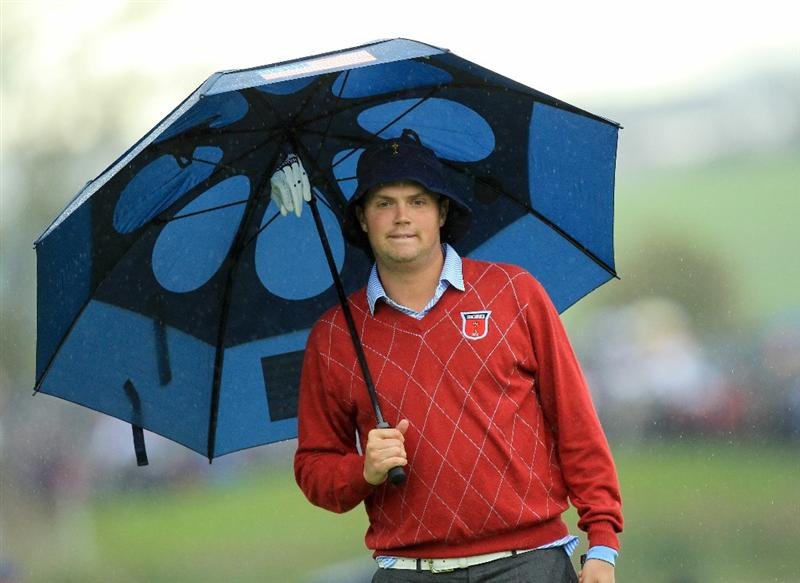 NEWPORT, WALES - OCTOBER 03:  Jeff Overton of the USA waits under an umbrella during the Fourball & Foursome Matches during the 2010 Ryder Cup at the Celtic Manor Resort on October 3, 2010 in Newport, Wales.  (Photo by David Cannon/Getty Images)