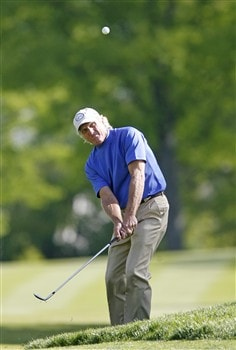 ROCHESTER NY - MAY 25: Greg Norman of Australia hits his third shot on the 17th hole during the final round of the 69th Senior PGA Championship at Oak Hill Country Club - East Course on May 25 2008 in Rochester, New York. (Photo by Hunter Martin/Getty Images)