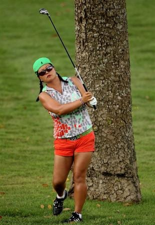 SINGAPORE - FEBRUARY 25:  Christina Kim of the USA hits her second shot on the fifth hole during the first round of the HSBC Women's Champions at the Tanah Merah Country Club on February 25, 2010 in Singapore.  (Photo by Andrew Redington/Getty Images)