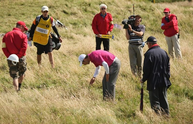 TURNBERRY, SCOTLAND - JULY 19:  Ross Fisher of England looks for his ball in the rough on the 5th hole during the final round of the 138th Open Championship on the Ailsa Course, Turnberry Golf Club on July 19, 2009 in Turnberry, Scotland.  (Photo by Ross Kinnaird/Getty Images)