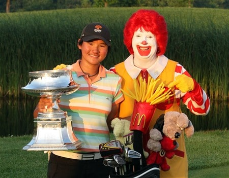 HAVRE DE GRACE, MD - JUNE 08:  Yani Tseng of Taiwan with the trophy and Ronald McDonald after her victory in a play-off after the final round of the 2008 McDonald's LPGA Championship held at Bulle Rock Golf Course, on June 8, 2008 in Havre de Grace, Maryland.  (Photo by David Cannon/Getty Images)
