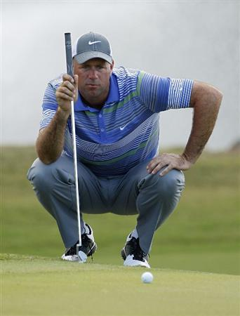 RIO GRANDE, PR - MARCH 10:  Stewart Cink lines up a putt during the first round of the Puerto Rico Open presented by seepuertorico.com at Trump International Golf Club on March 10, 2011 in Rio Grande, Puerto Rico.  (Photo by Michael Cohen/Getty Images)