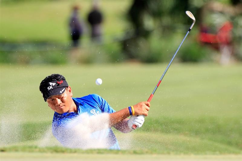 PONTE VEDRA BEACH, FL - MAY 15:  K.J. Choi of South Korea hits from a bunker during the final round of THE PLAYERS Championship held at THE PLAYERS Stadium course at TPC Sawgrass on May 15, 2011 in Ponte Vedra Beach, Florida.  (Photo by Sam Greenwood/Getty Images)***BESTPIX***