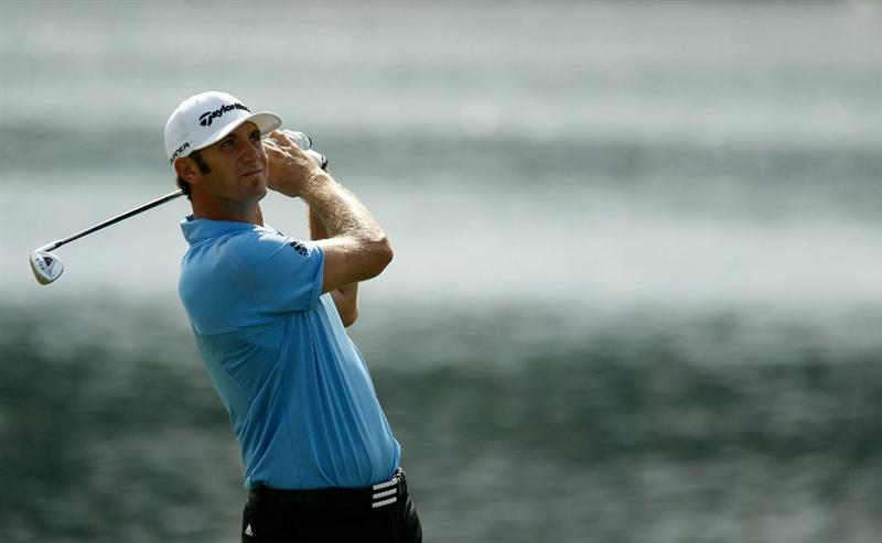 ATLANTA - SEPTEMBER 24:  Dustin Johnson hits his second shot on the 17th hole during the second round of THE TOUR Championship presented by Coca-Cola at East Lake Golf Club on September 24, 2010 in Atlanta, Georgia.  (Photo by Scott Halleran/Getty Images)