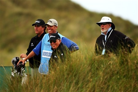 SOUTHPORT, UNITED KINGDOM - JULY 15:  Phil Mickelson of USA waits with his caddie Jim Mackay and coaches Butch Harmon and David Pelz during the second practice round of the 137th Open Championship on July 15, 2008 at Royal Birkdale Golf Club, Southport, England.  (Photo by Richard Heathcote/Getty Images)