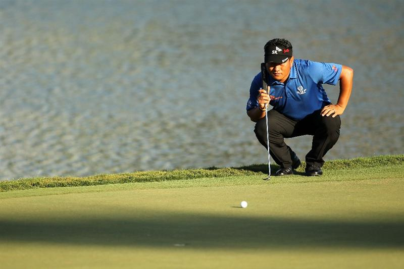 PONTE VEDRA BEACH, FL - MAY 15:  K.J. Choi of South Korea lines up a putt 17th hole during the final round of THE PLAYERS Championship held at THE PLAYERS Stadium course at TPC Sawgrass on May 15, 2011 in Ponte Vedra Beach, Florida.  (Photo by Mike Ehrmann/Getty Images)