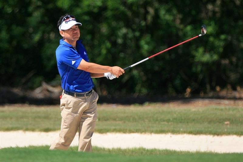 NEW ORLEANS, LA - APRIL 28 : Charlie Wi of South Korea hits his second shot on the 15th hole during the first round of the Zurich Classic at the TPC Louisiana on April 28, 2011 in New Orleans, Louisiana. (Photo by Hunter Martin/Getty Images)