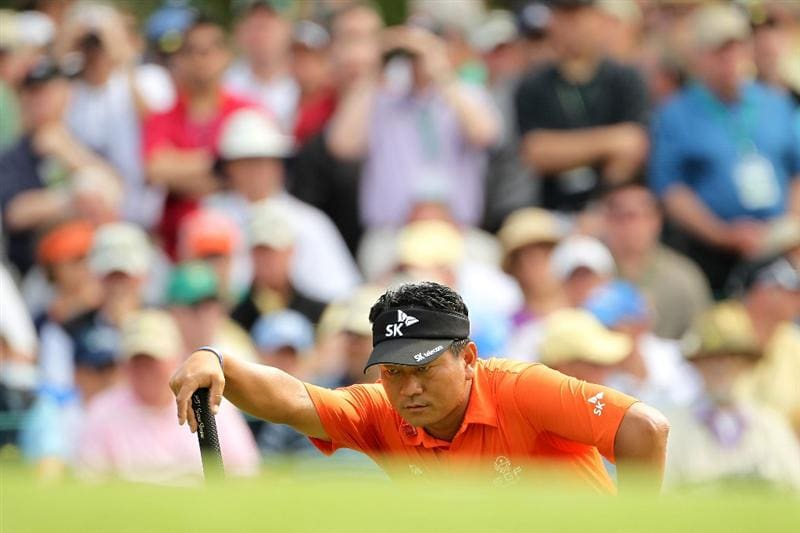AUGUSTA, GA - APRIL 08:  K.J. Choi of South Korea lines up a shot on the third hole during the second round of the 2011 Masters Tournament at Augusta National Golf Club on April 8, 2011 in Augusta, Georgia.  (Photo by Jamie Squire/Getty Images)