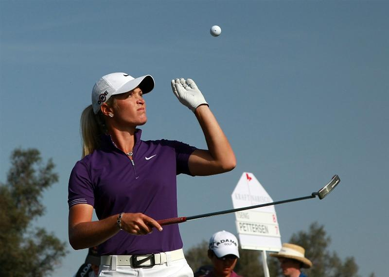 RANCHO MIRAGE, CA - APRIL 03:  Suzann Pettersen of Norway lifts her ball with her putter on the tee at the 16th hole during the third round of the 2010 Kraft Nabisco Championship, on the Dinah Shore Course at The Mission Hills Country Club, on April 3, 2010 in Rancho Mirage, California.  (Photo by David Cannon/Getty Images)