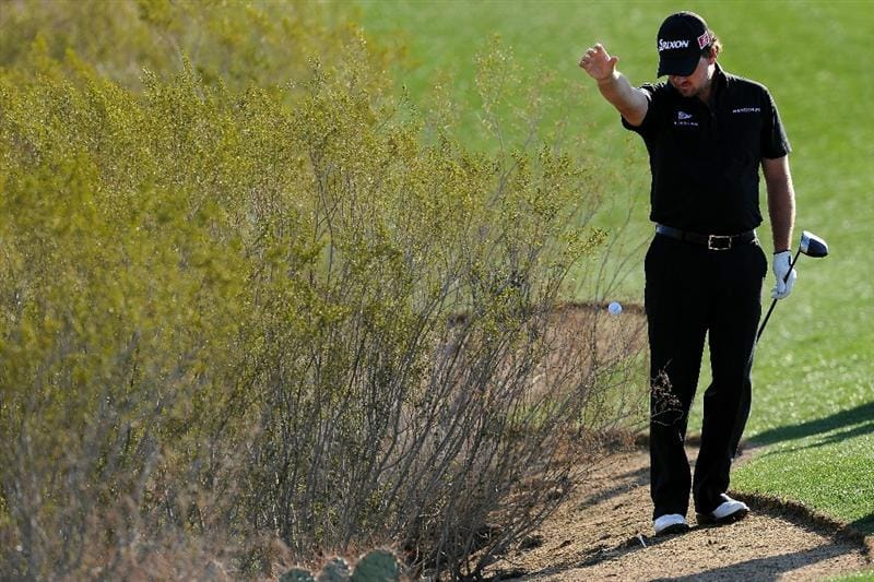 MARANA, AZ - FEBRUARY 24:  Graeme McDowell of Northern Ireland takes a drop on the first hole during the second round of the Accenture Match Play Championship at the Ritz-Carlton Golf Club on February 24, 2011 in Marana, Arizona.  (Photo by Stuart Franklin/Getty Images)
