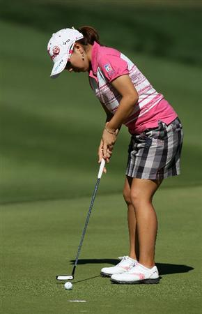 RANCHO MIRAGE, CA - APRIL 01:  Mika Miyazato of Japan putts on the 11th hole during the second round of the Kraft Nabisco Championship at Mission Hills Country Club on April 1, 2011 in Rancho Mirage, California.  (Photo by Stephen Dunn/Getty Images)