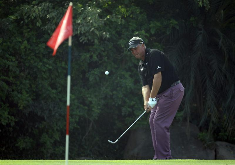 NEW DELHI, INDIA - FEBRUARY 14:  Darren Clarke of Northern Ireland chips during the Final Round of the Avantha Masters held at The DLF Golf and Country Club on February 14, 2010 in New Delhi, India.  (Photo by Ian Walton/Getty Images)