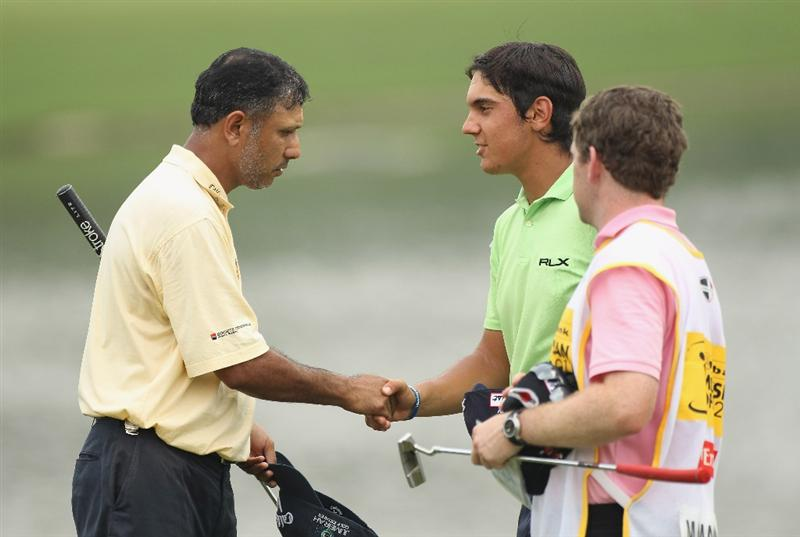 KUALA LUMPUR, MALAYSIA - APRIL 14:  Jeev Milka Singh of India (L) and Matteo Manassero of Italy shake hands during the first round of the Maybank Malaysian Open at Kuala Lumpur Golf & Country Club on April 13, 2011 in Kuala Lumpur, Malaysia.  (Photo by Ian Walton/Getty Images)