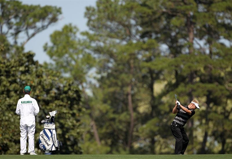 AUGUSTA, GA - APRIL 06:  Soren Kjeldsen of Denmark (R) hits a shot while his caddie looks on during a practice round prior to the 2010 Masters Tournament at Augusta National Golf Club on April 6, 2010 in Augusta, Georgia.  (Photo by Jamie Squire/Getty Images)