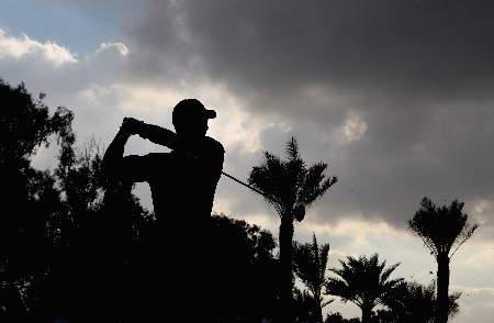DUBAI, UNITED ARAB EMIRATES - FEBRUARY 03:  Tiger Woods of the USA plays his second shot on the par five 18th hole during the final round of the Dubai Desert Classic on the Majlis Course held at the Emirates Golf Club on February 3, 2008 in Dubai,United Arab Emirates.  (Photo by Ross Kinnaird/Getty Images)