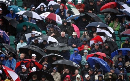 SOUTHPORT, UNITED KINGDOM - JULY 17:  Fans shelter from the rain under umbrellas during the First Round of the 137th Open Championship on July 17, 2008 at Royal Birkdale Golf Club, Southport, England.  (Photo by Andy Lyons/Getty Images)