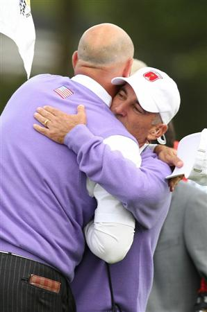 NEWPORT, WALES - OCTOBER 02:  USA Team Captain Corey Pavin hugs Stewart Cink on the 18th green during the rescheduled Afternoon Foursome Matches during the 2010 Ryder Cup at the Celtic Manor Resort on October 2, 2010 in Newport, Wales.  (Photo by Ross Kinnaird/Getty Images)