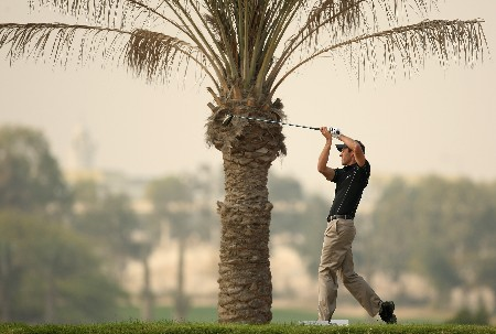 DOHA, QATAR - JANUARY 26:  Charl Schwartzel of South Africa on the par four 11th hole during the third round of the Commercialbank Qatar Masters held at the Doha Golf Club on January 26, 2008 in Doha,Qatar.  (Photo by Ross Kinnaird/Getty Images)