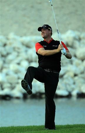 BAHRAIN, BAHRAIN - JANUARY 30:  Peter Hanson of Sweden plays his second shot from an awful lie at the 18th hole during the final round of the 2011 Volvo Champions held at the Royal Golf Club on January 30, 2011 in Bahrain, Bahrain.  (Photo by David Cannon/Getty Images)