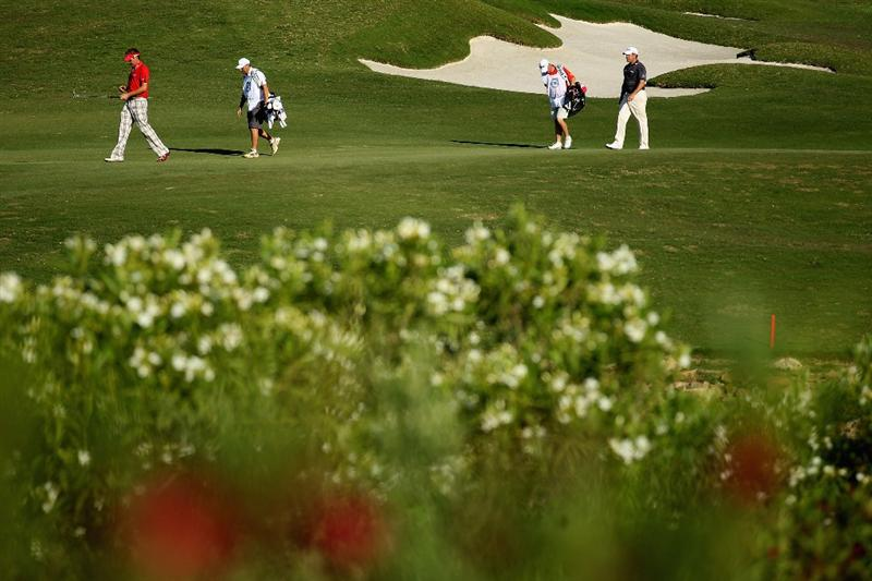 CASARES, SPAIN - MAY 21:  Englishmen Ian Poulter and Lee Westwood walk down the third fairway during their last 16 match of the Volvo World Match Play Championships at Finca Cortesin on May 20, 2011 in Casares, Spain.  (Photo by Warren Little/Getty Images)