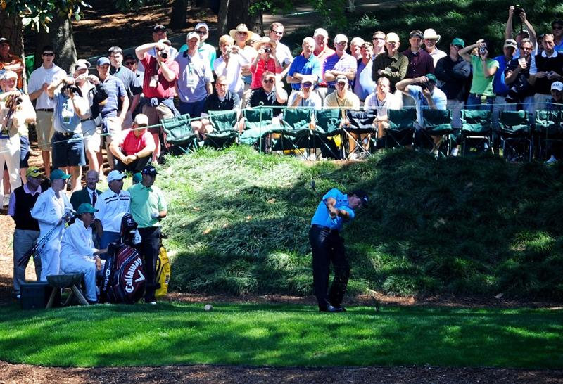 AUGUSTA, GA - APRIL 06:  Phil Mickelson hits a shot as a gallery of fans looks on during the Par 3 Contest prior to the 2011 Masters Tournament at Augusta National Golf Club on April 6, 2011 in Augusta, Georgia.  (Photo by Harry How/Getty Images)