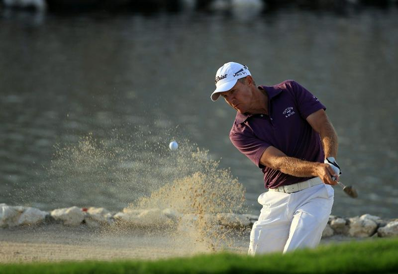 BAHRAIN, BAHRAIN - JANUARY 29:  James Kingston of South Africa plays his third shot at the 18th hole during the third round of the 2011 Volvo Champions held at the Royal Golf Club on January 29, 2011 in Bahrain, Bahrain.  (Photo by David Cannon/Getty Images)