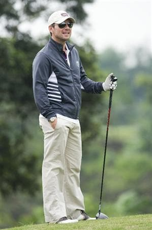 HAIKOU, CHINA - OCTOBER 29: Actor Christian Slater waits to tee off on the 2nd hole during day three of the Mission Hills Start Trophy tournament at Mission Hills Resort on October 29, 2010 in Haikou, China. The Mission Hills Star Trophy is Asia's leading leisure liflestyle event which features Hollywood celebrities and international golf stars.  (Photo by Victor Fraile/Getty Images for Mission Hills)