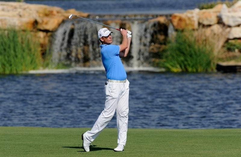VILLAMOURA, PORTUGAL - OCTOBER 16:  Robert Karlsson of Sweden plays his approach shot on the seventh hole during the third round of the Portugal Masters at the Oceanico Victoria Golf Course on October 16, 2010 in Villamoura, Portugal.  (Photo by Stuart Franklin/Getty Images)
