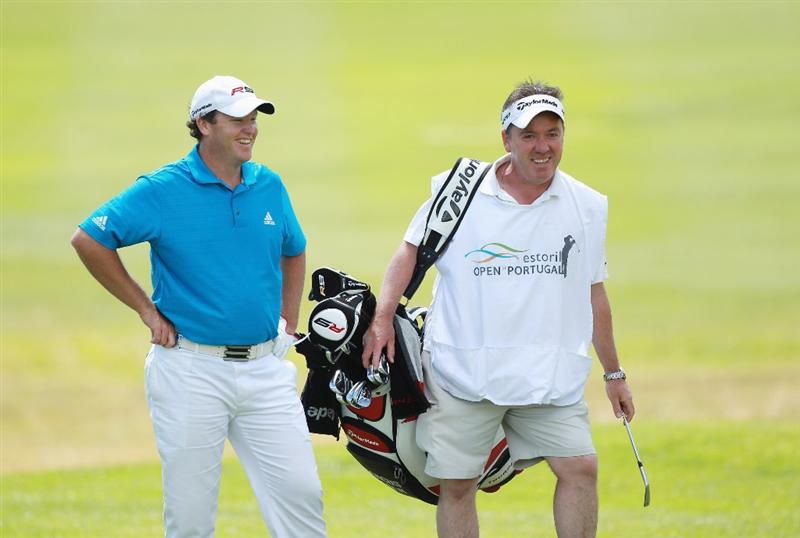 ESTORIL, PORTUGAL - JUNE 10:  Marcus Fraser of Australia laughs with his caddie Mick Donaghy during the first round of the Estoril Open de Portugal at Penha Longa Golf Club on June 10, 2010 in Estoril, Portugal.  (Photo by Warren Little/Getty Images)