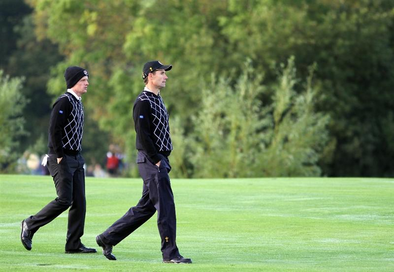 NEWPORT, WALES - OCTOBER 02:  Luke Donald of Europe walks down a fairway with team mate Padraig Harrington (R) during the rescheduled Morning Fourball Matches during the 2010 Ryder Cup at the Celtic Manor Resort on October 2, 2010 in Newport, Wales.  (Photo by Jamie Squire/Getty Images)