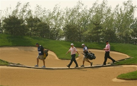 BEIJING - APRIL 17:  Richard Finch of England and Phillip Price walk to the 5th tee during the first round of the Volvo China Open at the Beijing CBD International Golf Club on April 17, 2007 in Beijing, China.  (Photo by Ian Walton/Getty Images)