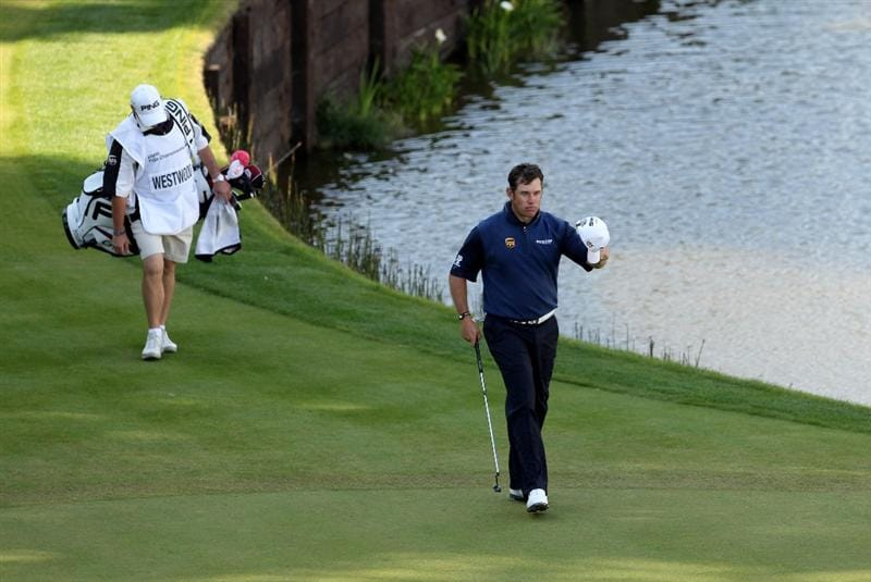 VIRGINIA WATER, ENGLAND - MAY 29:  Lee Westwood of England acknowledges the crowd on the 18th green during the final round of the BMW PGA Championship  at the Wentworth Club on May 29, 2011 in Virginia Water, England.  (Photo by Andrew Redington/Getty Images)