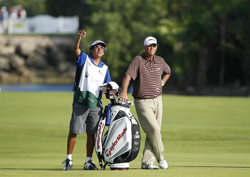 PLAYA DEL CARMEN, MEXICO - FEBRUARY 25:  Tom Lehman (R) stands by his golf bag as his caddie Andy Martinez tests the wind during the second round of the Mayakoba Golf Classic at Riviera Maya-Cancun held at El Camaleon Golf Club on February 25, 2011 in Playa del Carmen, Mexico.  (Photo by Michael Cohen/Getty Images)
