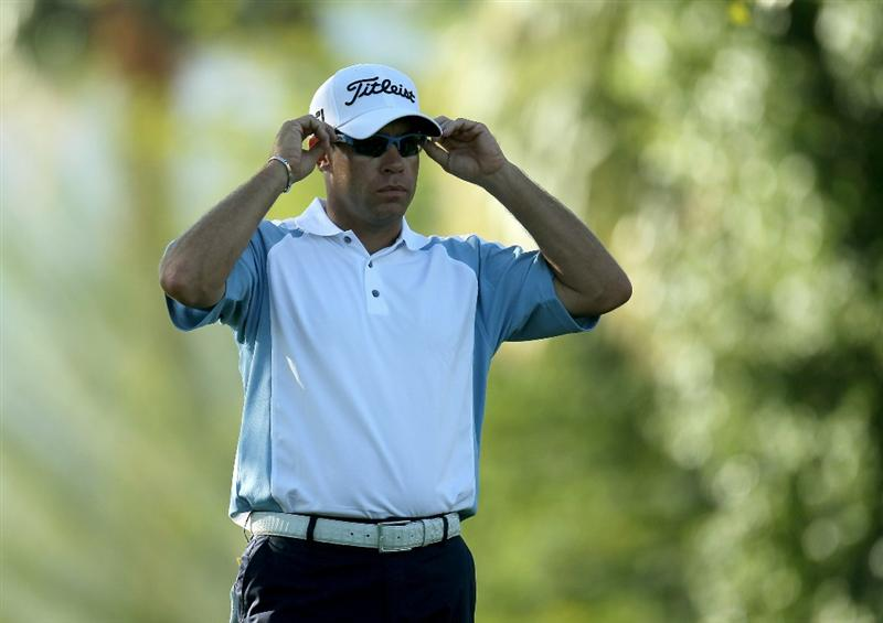 LA QUINTA, CA - JANUARY 19:  Brian Davis of England adjusts his sunglasses as he waits to hit his tee shot on the second hole during round one of the Bob Hope Classic at the Palmer Private Course at PGA West on January 19, 2011 in La Quinta, California.  (Photo by Stephen Dunn/Getty Images)