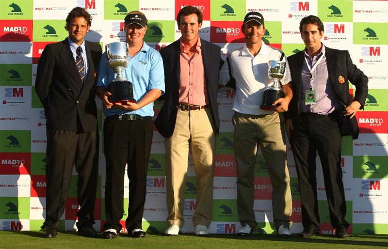 MADRID, SPAIN - OCTOBER 11:  Ross McGowan of England (2nd-L) celebrates with the trophy after winning the Final Round of the Madrid Masters at Cantro Nacional De Golf on October 9, 2009 in Madrid, Spain.  (Photo by Ian Walton/Getty Images)