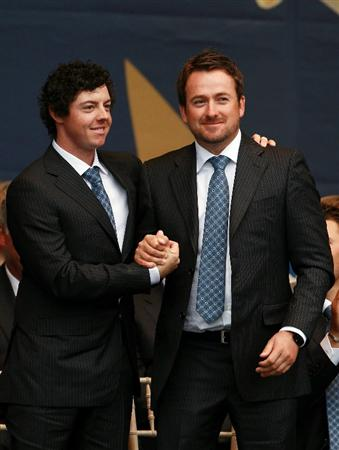 NEWPORT, WALES - SEPTEMBER 30:  Rory McIlroy (L) and Graeme McDowell of Europe stand together during the Opening Ceremony prior to the 2010 Ryder Cup at the Celtic Manor Resort on September 30, 2010 in Newport, Wales.  (Photo by Andrew Redington/Getty Images)