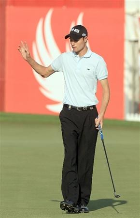 ABU DHABI, UNITED ARAB EMIRATES - JANUARY 21:  Rhys Davies of Wales  birdies the par 5, 18th hole during the first round of The Abu Dhabi Golf Championship at Abu Dhabi Golf Club on January 21, 2010 in Abu Dhabi, United Arab Emirates.  (Photo by David Cannon/Getty Images)
