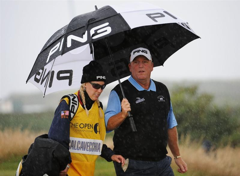 TURNBERRY, SCOTLAND - JULY 17:  Mark Calcavecchia of USA walks in the rain with his wife/caddy Brenda  during round two of the 138th Open Championship on the Ailsa Course, Turnberry Golf Club on July 17, 2009 in Turnberry, Scotland.  (Photo by Harry How/Getty Images)