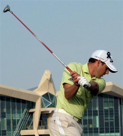 ABU DHABI, UNITED ARAB EMIRATES - JANUARY 23:  Sergio Garcia of Spain makes a practice swing on the par five 18th hole during the third round of the Abu Dhabi Golf Championship at the Abu Dhabi Golf Club on January 23, 2010 in Abu Dhabi, United Arab Emirates.  (Photo by Ross Kinnaird/Getty Images)
