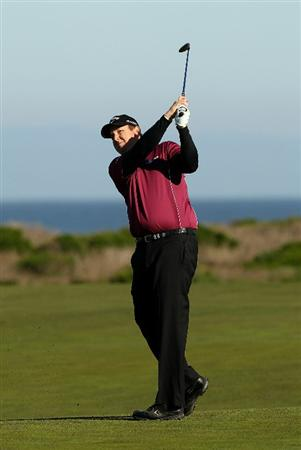 PEBBLE BEACH, CA - FEBRUARY 11:  J.J. Henry hits his second shot on the 13th hole during the second round of the AT&T Pebble Beach National Pro-Am at Monterey Peninsula Country Club on February 11, 2011 in Pebble Beach, California.  (Photo by Ezra Shaw/Getty Images)