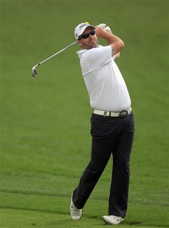 DUBAI, UNITED ARAB EMIRATES - FEBRUARY 04:  Kenneth Ferrie of England plays his second shot to the par 4, 14th hole during the first round of the 2010 Omega Dubai Desert Classic on the Majilis Course at the Emirates Golf Club on February 4, 2010 in Dubai, United Arab Emirates.  (Photo by David Cannon/Getty Images)
