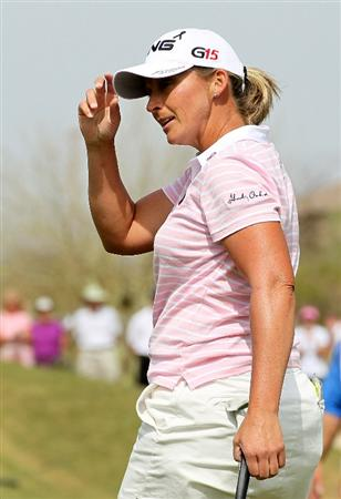 PHOENIX, AZ - MARCH 19:  Angela Stanford tips her cap as she finishes her round on the 18th hole during the second round of the RR Donnelley LPGA Founders Cup at Wildfire Golf Club on March 19, 2011 in Phoenix, Arizona.  (Photo by Stephen Dunn/Getty Images)