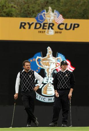 NEWPORT, WALES - OCTOBER 02:  Graeme McDowell (L) and Rory McIlroy of Europe wait on the 18th green during the rescheduled Afternoon Foursome Matches during the 2010 Ryder Cup at the Celtic Manor Resort on October 2, 2010 in Newport, Wales.  (Photo by Ross Kinnaird/Getty Images)