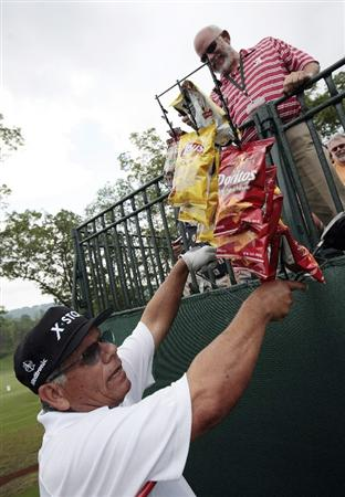 BIRMINGHAM, AL - MAY 14:  Lee Trevino tries to give away snacks to fans that he picked up on the first tee during the Thursday Pro-AM of the Regions Charity Classic at the Robert Trent Jones Golf Trail at Ross Bridge on May 14, 2009  in Birmingham, Alabama. (Photo by Dave Martin/Getty Images)