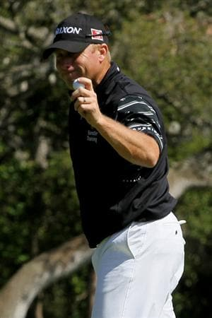 PEBBLE BEACH, CA - JUNE 17:  John Rollins reacts to his birdie on the 14th hole during the first round of the 110th U.S. Open at Pebble Beach Golf Links on June 17, 2010 in Pebble Beach, California.  (Photo by Stephen Dunn/Getty Images)