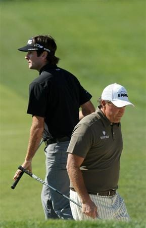 LA JOLLA, CA - JANUARY 29:  Bubba Watson walks past Phil Mickelson after hitting the ball out of the 6th bunker during Round 3 of the Farmers Insurance Open at Torrey Pines on January 29, 2011 in La Jolla, California. (Photo by Donald Miralle/Getty Images)