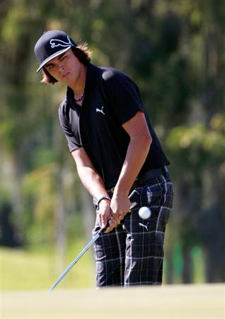 LAKE BUENA VISTA, FL - NOVEMBER 11:  Rickie Fowler plays a shot on the 9th hole during the first round of the Children's Miracle Network Classic at the Disney Palm and Magnolia courses on November 11, 2010 in Lake Buena Vista, Florida.  (Photo by Sam Greenwood/Getty Images)