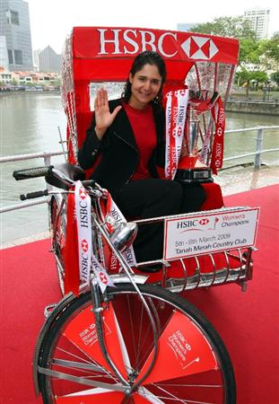 SINGAPORE - MARCH 03:  Lorena Ochoa of Mexico, the defending champion, poses with the trophy on a trishaw during a photocall and press conference in downtown Singapore prior to the start of the HSBC Women's Champions at Tanah Merah Country Club on March 3, 2009 in Singapore.  (Photo by Andrew Redington/Getty Images)