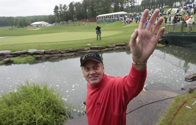 BIRMINGHAM, AL - MAY 17:  Keith Fergus waves to the crowd after completing play on the 18th hole during the rain delayed second round of the Regions Charity Classic at the Robert Trent Jones Golf Trail at Ross Bridge on May 17, 2009 in Birmingham, Alabama. Fergus won the rain-shortened 36-hole tournament with a score of 12-under par. (Photo by Dave Martin/Getty Images)